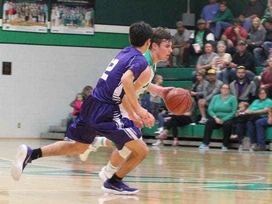 Wall's Tymber Carr dribbles up the court against Abilene