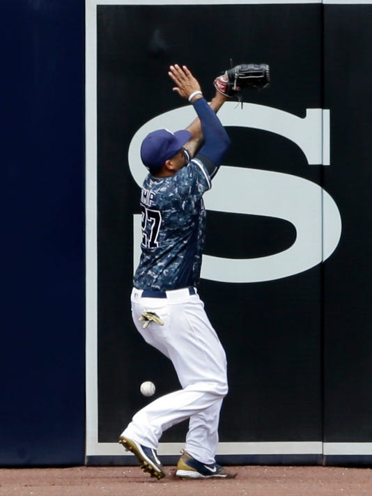 San Diego Padres right fielder Matt Kemp can't reach a ball hit for a triple by St. Louis Cardinals' Jedd Gyorko during the fourth inning of a baseball game, Sunday, April 24, 2016, in San Diego. (AP Photo/Gregory Bull)