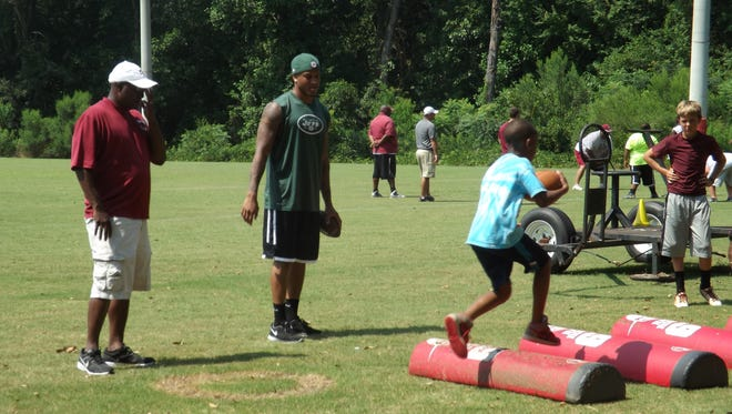 Millbrook native and Jets cornerback Dee Milliner, center, watches over players at his football camp on Monday at Stanhope Elmore High.