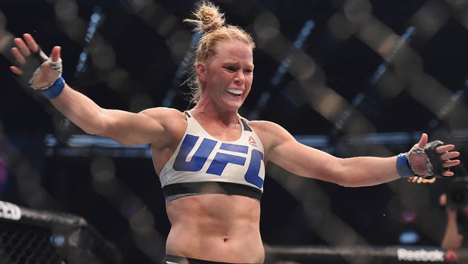 Holly Holm celebrates after defeating Ronda Rousey during UFC 193 at Etihad Stadium in Australia.