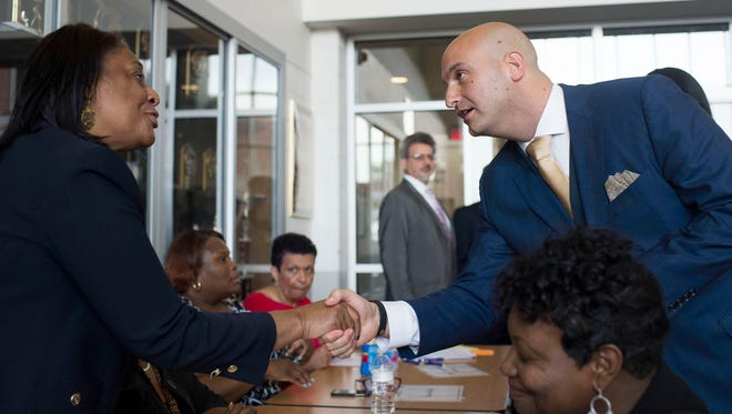 From left, Deborah Washington, DPSCD supervisor for the autism and early childhood special education program, greets new Detroit Superintendent Nikolai Vitti during the DPSCD Teacher Recruitment Fair on Tuesday, May 23, 2017 at Martin Luther King High School in Detroit. Vitti attended the Fair as part of his first day as Superintendent.