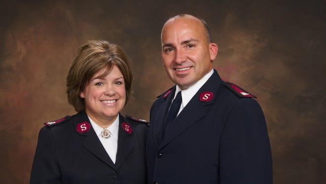 Majors Robert and Lisa Mueller