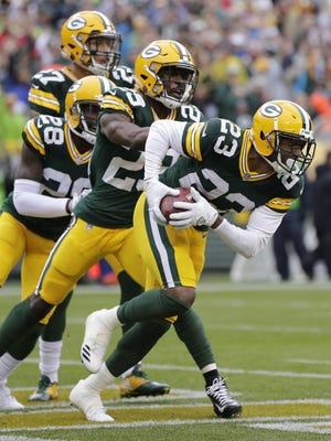 Green Bay Packers cornerback Damarious Randall (23) celebrates his interception against the New Orleans Saints in the first half Sunday, October 22, 2017, at Lambeau Field.