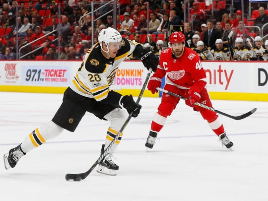 Boston Bruins center Riley Nash (20) shoots against the Detroit Red Wings in the first period of an NHL hockey game Wednesday, Dec. 13, 2017, in Detroit. (AP Photo/Paul Sancya)