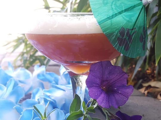 A witch doctor cocktail, created by Reno mixologist Nicole Barker, includes absinthe-infused egg whites.