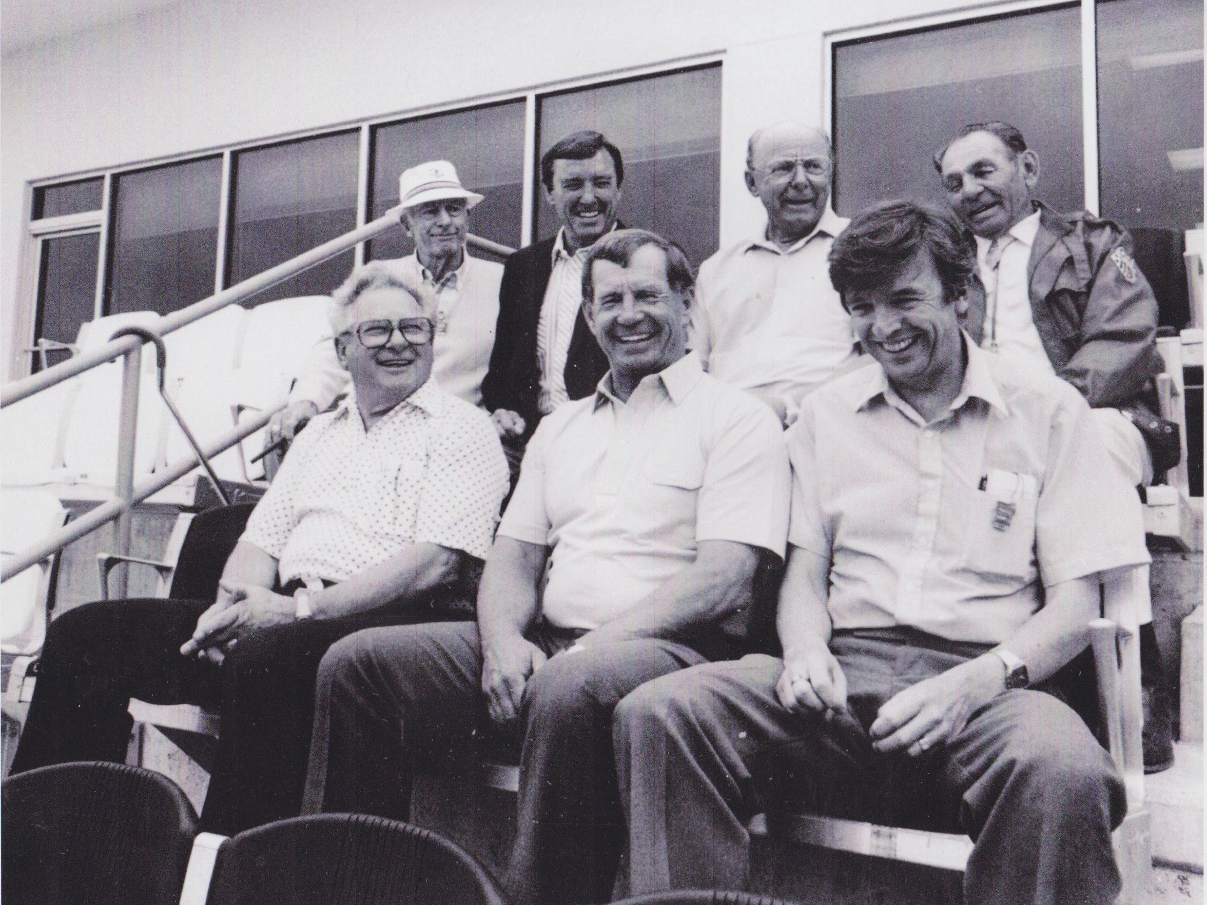 Donald Davidson is joined by racing royalty: (Top row, left to right) Sam Hanks, Johnny Rutherford, Jim Rathmann and  Louis Meyer; (bottom row, left to right)  Rodger Ward, Parnelli Jones and Davidson.