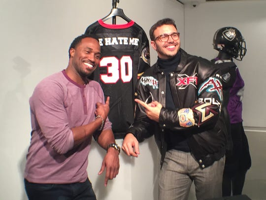 Rod Smart and director Charlie Ebersol pose in front of a He Hate Me jersey at the opening reception for the pop-up XFL Hall of Fame in New York in January 2017. Ebersol directed a documentary on the 2001 football league.