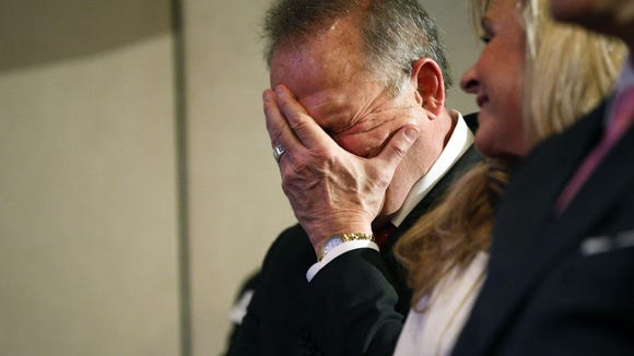 Former Alabama Chief Justice and U.S. Senate candidate Roy Moore waits to speak at a press conference, Thursday, Nov. 16, 2017, in Birmingham, Ala. (AP Photo/Brynn Anderson)