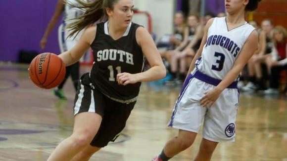 Clarkstown South's Kayla Tucek passes New Rochelle's