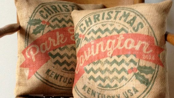 """Fort Wright resident Stephanie Redman says burlap pillows are """"warm and fuzzy"""" as a holiday gift. They are retro and the hometown names remind people of being home for the holidays."""
