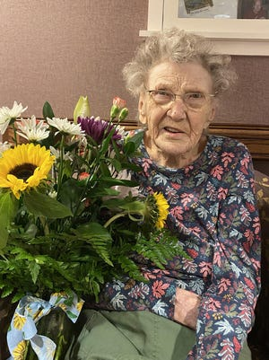 Priscilla Swanson is pictured with flowers from Tanglewood Manor owner Nick Ferreri after returning this week to Memory Garden in West Ellicott. Swanson had tested positive for COVID-19 and spent two weeks in the intensive care unit at UPMC Chautauqua.
