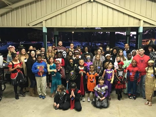 Children, mentors and volunteers are pictured during a Halloween party at Girard Park put on by Big Brothers Big Sisters of Acadiana and the Junior League of Lafayette.