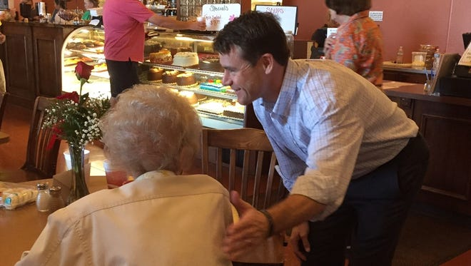 Todd Young, Republican candidate for the Senate, visits with customers at Concannon's Bakery Cafe in Muncie on Sunday, Sept. 25, 2016.