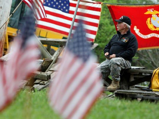 Vietnam veteran Pat Dizzine looks at the watchfire