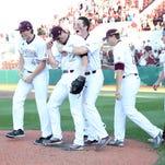 Mississippi State celebrates winning the SEC regular-season championship on Saturday.