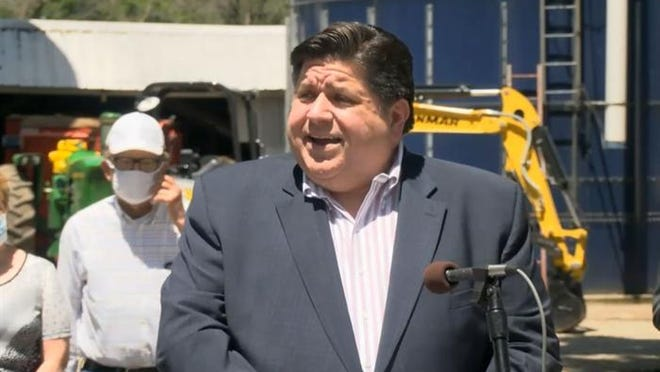 Gov. JB Pritzker speaks in the Henry County town of Geneseo on Wednesday to announce the awarding of $50 million in grants to 28 projects aimed at expanding broadband internet access across the state.