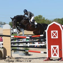 """The National Equestrian Center hosted riders from across the nation Sunday for the Grand Prix Competition.  The competition was presented by the St. Louis National Charity Horse Show.  The horse """"Southern Pride"""" won Sunday's competition with rider Karen Cudmore."""