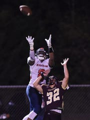 Roy C. Ketcham's Zaahir Woody leaps to make a spectacular catch in a Sept. 9 game against Arlington.