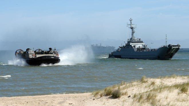 NATO troops make a massive amphibious landing off the coast of Ustka, northern Poland, during NATO military sea exercises in 2015 in the Baltic Sea. The multinational exercise of NATO allied and partner nations aims to demonstrate their collective capability to defend the Baltic region.