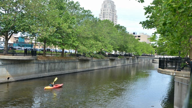Jenna Crowe navigates the Battle Creek River Thursday in a stretch of the river through downtown Battle Creek.