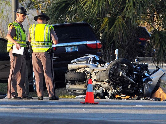 Florida Highway Patrol troopers investigate the scene of a fatal motorcycle crash on Merritt Island in March 2016.