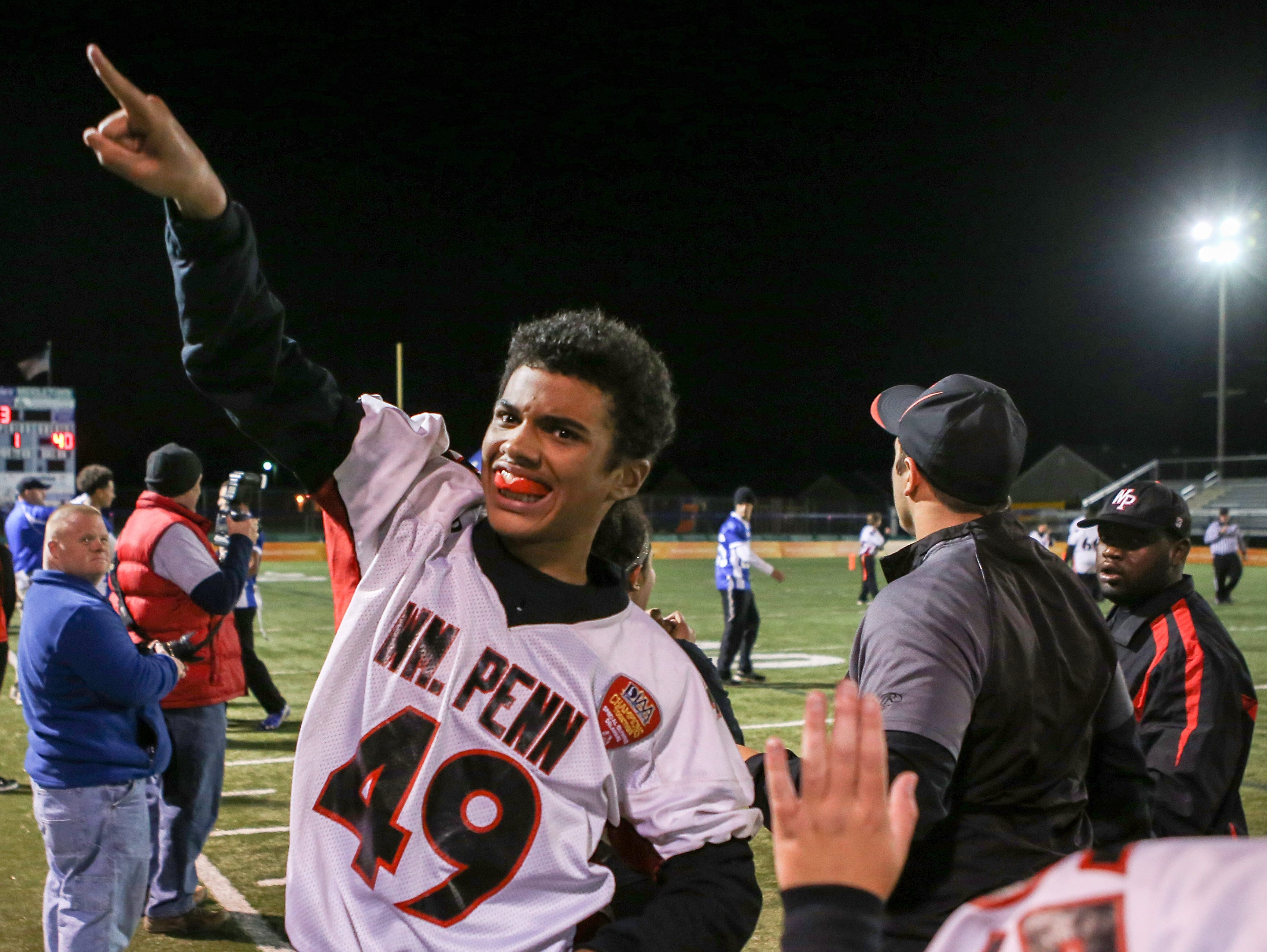 William Penn athlete Nick Kane celebrates his team's win over Middletown.