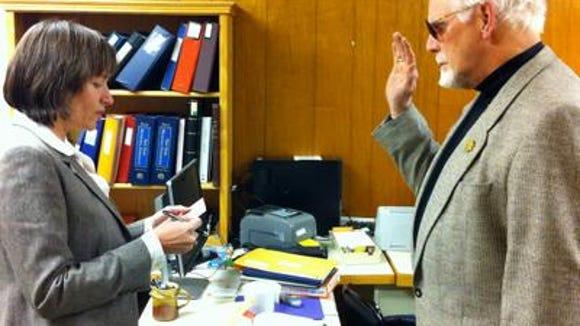 John Hertzler is sworn in as a Ulysses Town Board member.