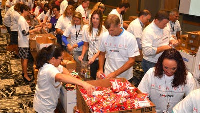 Approximately 400 local Harris Corp. employees spent their lunch hour Wednesday at the Harris Technology Center assembling 11,000 food packs that will be donated to the Children's Hunger Project . This was the kick off to the company's United Way campaign.