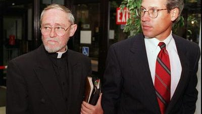 Rev. Patrick Moloney and attorney William Clauss.