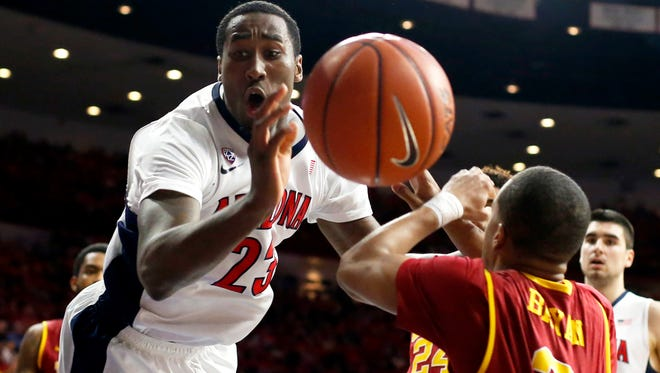 Arizona forward Rondae Hollis-Jefferson gets fouled by USC guard Chass Bryan (3) during the second half on Thursday, Feb. 19, 2015, in Tucson.
