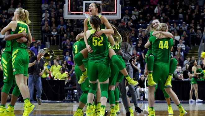 The Oregon Ducks celebrate their win over the Maryland Terrapins in the semifinals of the Bridgeport Regional of the women's 2017 NCAA Tournament at Webster Bank Arena. Oregon defeated Maryland 77-63.
