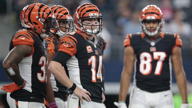 Cincinnati Bengals quarterback Andy Dalton (14) rests his hands on his hips as he waits for the offensive play call in the second quarter during the NFL football game between the Cincinnati Bengals and the Dallas Cowboys, Sunday, Oct. 9, 2016, at AT&T Stadium in Arlington, Texas.