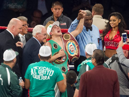 Diego De La Hoya, in green-and-white striped shorts, fights against Randy Caballero at the T-Mobile Arena in Las Vegas, Nevada on September 16, 2017. De La Hoya won the fight. De La Hoya's record improves to 20-0 (9 KOs) and Caballero gets his first loss as a professional with a record of 24-1 (14 KOs).