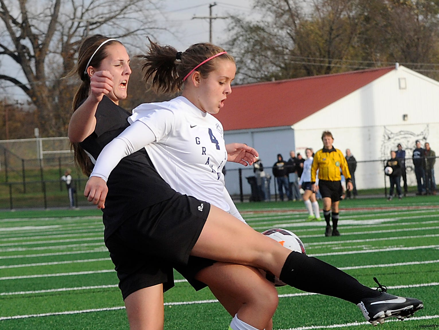 Tri-Valley defender Jenni Walker tries to block Granville's Taylor Beitzel from the goal as she earns her second of three goals. Granville defeated Tri-Valley 10-1 in the Division II regional final on Saturday, Nov. 7, 2015, at White Field in Newark. The Blue Aces will advance to play Indian Hill in the state tournament.