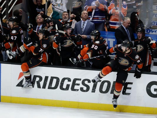 Players on the Anaheim Ducks' bench start to celebrate the team's 2-1 win over the Edmonton Oilers in Game 7 of a second-round NHL hockey Stanley Cup playoff series in Anaheim, Calif., Wednesday, May 10, 2017. (AP Photo/Chris Carlson)