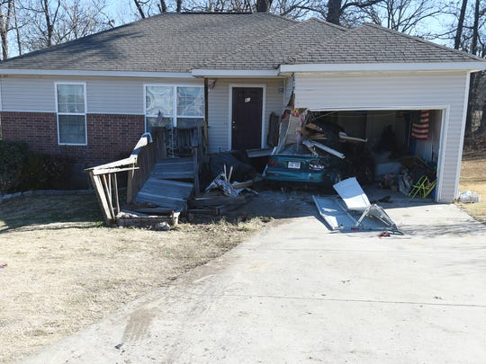 A mangled Mustang can be seen sticking out of the garage of this Gassville home after Ronald Aaron Love rammed the vehicle with his truck. On Thursday, Love plead guilty to three charges of second-degree battery stemming from ramming the house with his vehicle.   half in the crushed garage of a Gassville home Monday after Ronald AarLove allegedly rammed the car and the home several times.