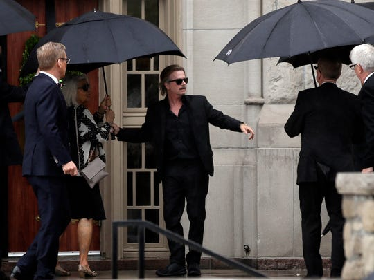Actor-comedian David Spade helps family members enter Our Lady of Perpetual Help Redemptorist Catholic Church for funeral services for his sister-in-law, designer Kate Spade on Thursday.
