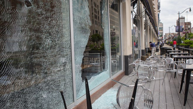 Broken windows on the Lazarus building Downtown can be seen the morning after protests in the streets of Columbus caused damage to many businesses on May 29.