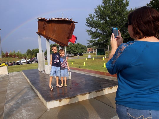 Jennifer Hokanson takes a photo of her sons Jenson,