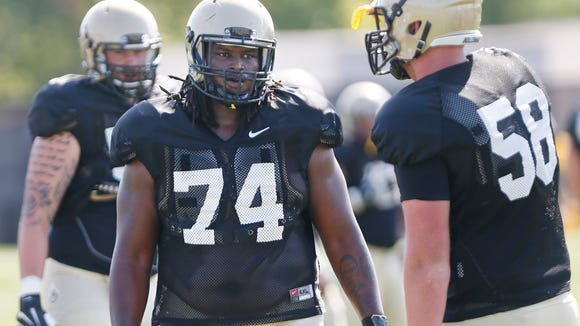 Martesse Patterson (74) and the offensive line run drills during Purdue football practice Monday, August , 2016, at the Bimel Practice Complex.