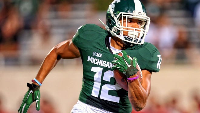 Michigan State wide receiver R.J. Shelton runs after a catch against Jacksonville State.