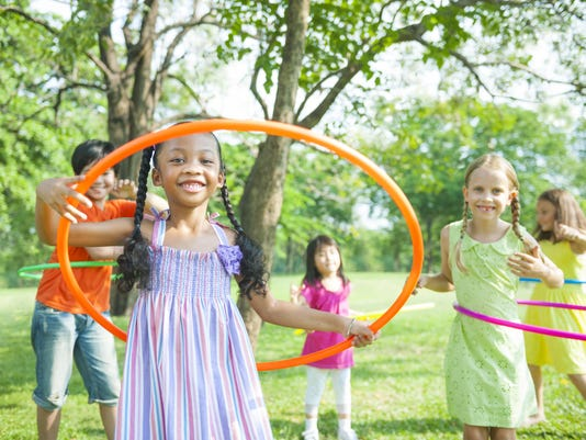 Multiracial kids playing hoops outside