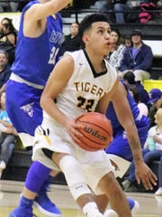 Alamogordo's Abner Herrera eyes the basket during a
