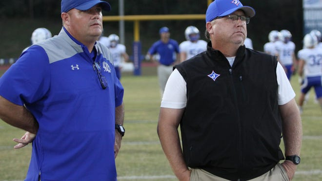 Oconee County head coach Travis Noland and Jefferson head coach Gene Cathcart at Jefferson Memorial Stadium before a game in 2017.