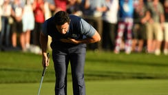 Rory McIlroy reacts after winning his match in the