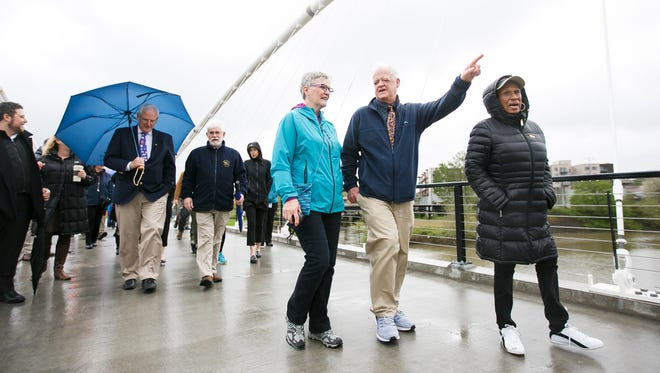 (Right to left) Senator Jackie Winters, Senate President Peter Courtney, and former city manager Linda Norris cross the Peter Courtney Minto Island Bridge on Thursday, April 27, 2017. The bridge opens to the public on Friday morning at 6 a.m., and, after closing in June for final construction, will have a grand opening in August.