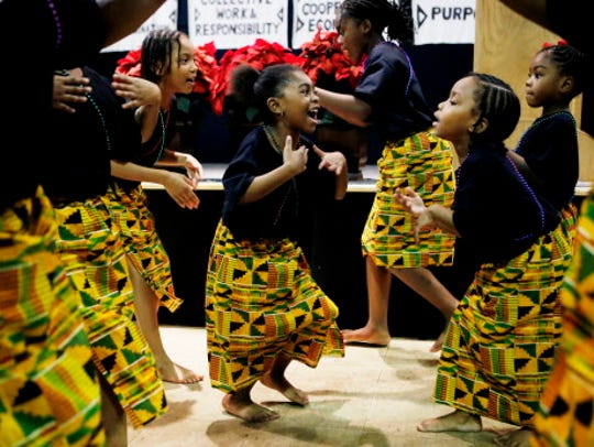 Young dancers perform a traditional African Manjani