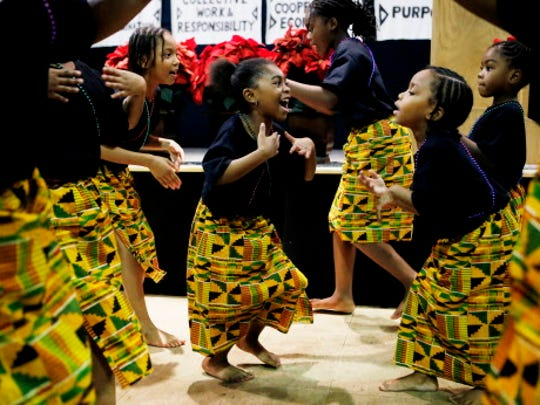 Young dancers perform a traditional African Manjani dance during a Kwanzaa celebration marking the first day of Kwanzaa at the Wisconsin Black Historical Society, 2620 W. Center St. in Milwaukee.