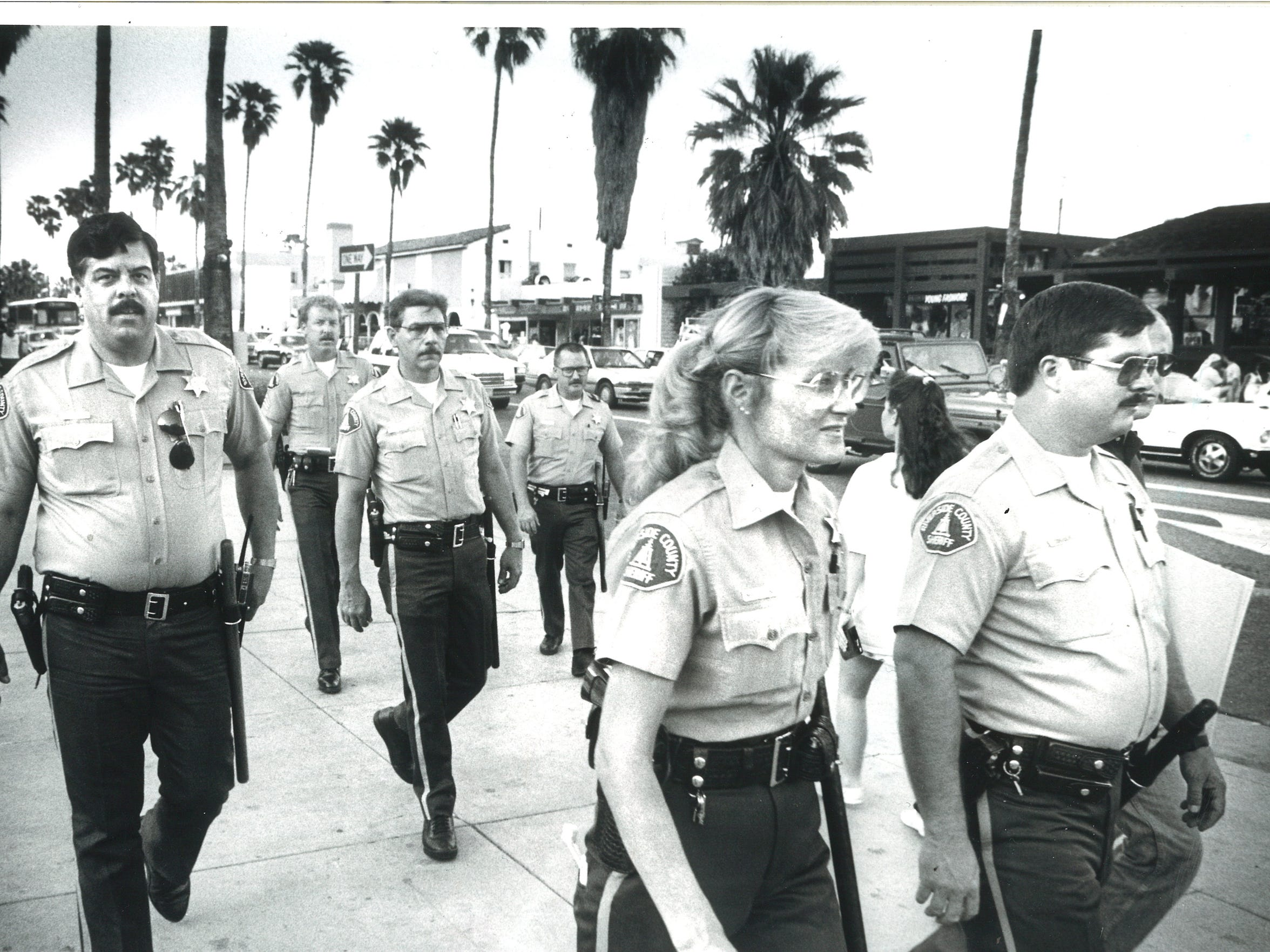 Riverside County sheriff's deputies patrol the streets of downtown Palm Springs during spring break 1988, two years after the riot.