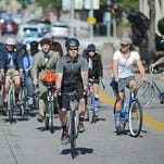 Chris Parsley, president of Falls Area Bicyclists, leads a group of cyclists north on Phillips Avenue as part of the Falls Area Bicyclists' Tweed Ride Sunday, Sept. 27, 2015, in downtown Sioux Falls.